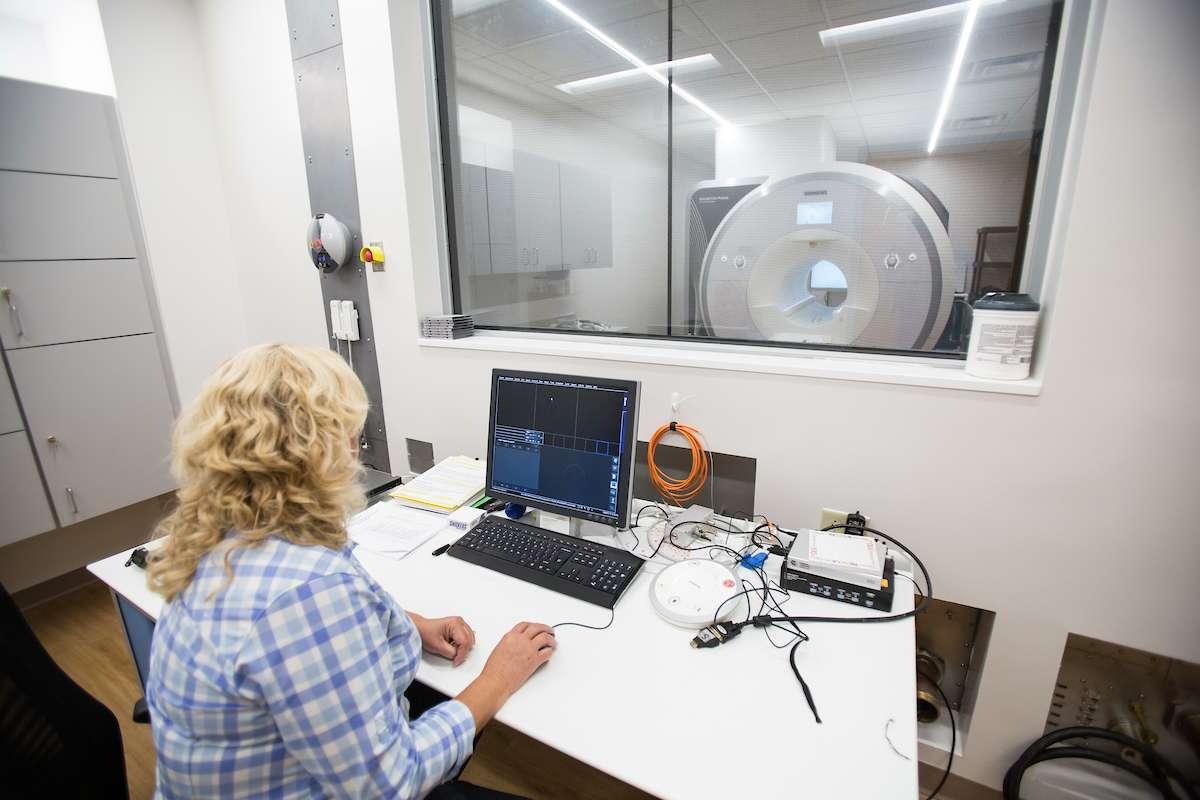 Researcher conducting an MRI scan