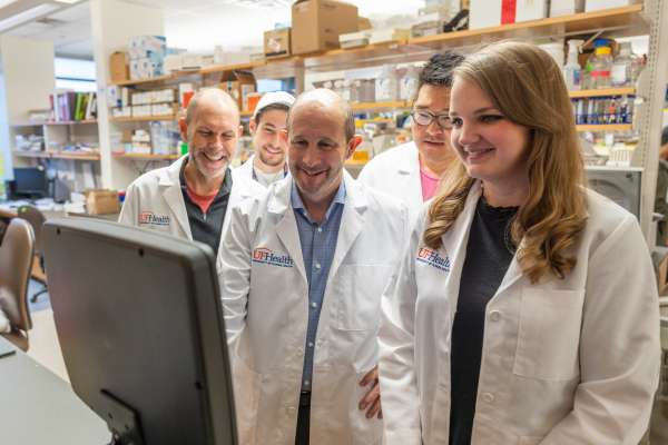 doctor golde with researchers in the lab